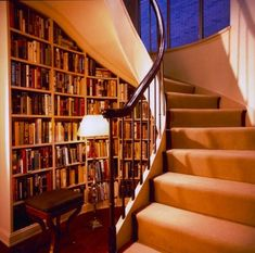 Bookcase nook at the bottom of the stairs. Perfect!