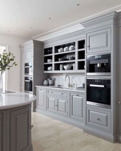 grey kitchen designs A contemporary curved grey island is a perfect addition to any modern kitchen space, oak internal storage adds a contemporary twist to a classic kitchen. Tom Howley Kitchens, Grey Kitchens, Cool Kitchens, Kitchen Cabinets For Sale, Kitchen Cabinet Design, Interior Design Kitchen, Island Kitchen, Oak Cabinets, Rustic Kitchen Decor