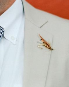 Luke, who loves fly-fishing, pinned a decorative lure from Royal Treatment Fly Fishing to his buttonhole.
