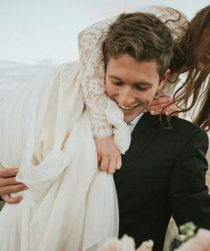 wedding pics   over the shoulder   candid   laughs   outdoor   bride and groom