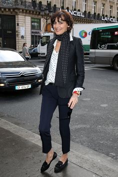 """""""10 lessons to master the offbeat look à la Parisienne. Among them: wearing jeans with gem-encrusted sandals, not sneakers; a pencil skirt with ballet flats, not heels; an evening dress with a straw handbag, not a gold clutch; a chiffon print dress with battered biker boots, not brand-new ballet flats; a sequined sweater with men's trousers, not a skirt; a tuxedo jacket with sneakers, not femme fatale stilettos. The perfect Parisienne never uses soap on her face or wears pink on her lips or…"""