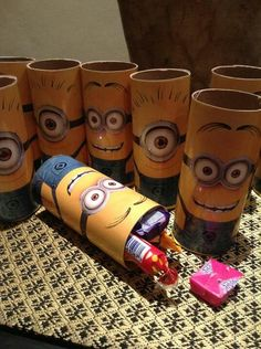 despicable me minion birthday party favors using toilet paper rolls, looks like they laminated a colored copy of a minion and glued it to a toilet paper roll.