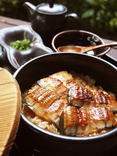 Unadon ~ Japanese BBQ eel over rice ~ sprinkle it with aromatic Japanese black pepper to add a bit of kick. Japanese Dishes, Japanese Food, My Favorite Food, Favorite Recipes, Sushi, Bento, Good Food, Yummy Food, Eat This
