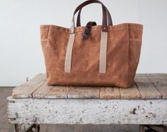 I originally designed this waxed canvas and leather tote for a carpenter, but its sturdy, utilitarian form allows for many functions including (but