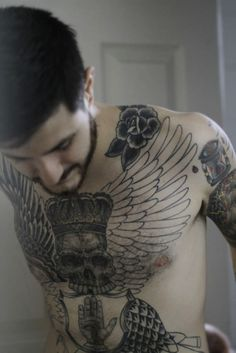 chest wing tattoo, skull tattoo