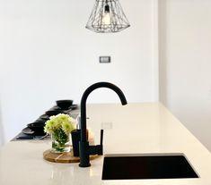 Modern kitchen area with black tap, modern painting, white kitchen bench, black plates Black Plates, Minimalist Design, Modern Painting, White Kitchen Bench, Kitchen Benches, 3 Bedroom House, House, Modern, Home Decor