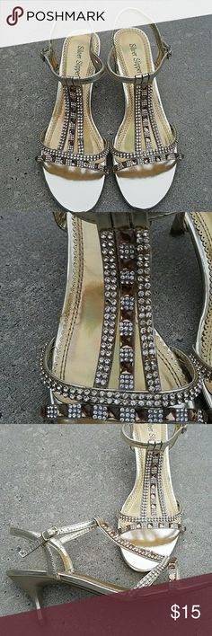 """Gold heels with bling rhinestones Gold dressy heels. Wore once and are in good condition. One rinestone is missing as shown in the second picture, you could probably move one from The side.  The pictures just don't show how shiny and sparkly they are.  2 1/2"""" heel. Shoes Heels"""