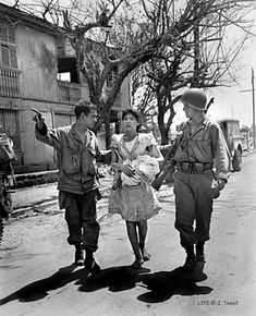 5 American soldiers helping a Filipino lady to safety and help, Manila, Philippines, Feb. Philippines People, Philippines Culture, Manila Philippines, Jose Rizal, Filipino Culture, Bataan, Time Inc, European American, American Soldiers