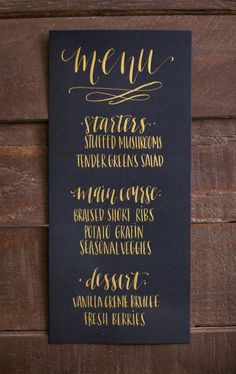 black and gold menu in modern calligraphy