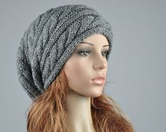 Hand knit hat - Charcoal hat, slouchy hat, cable pattern hat. $38.00, via Etsy.