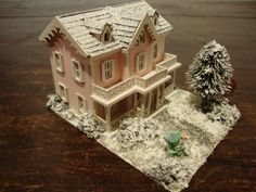 miniature house in 1/144 scale the house is pink, with grey roof.  ornaments , windows, the porch and balcony white in the garden, the pine and all the bushes are covered with snow. a small snowman makes cheerful garden, the driveway has been shoveled. and also the roof is covered with snow.  as with the photos can not show everything, I will try to describe what is contained in this small house ,  nothing is missing .  on the first floor there is a modern kitchen with stove, fridge sink…