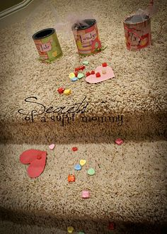 """Valentine's Gift Can's...1.I leave these cans sitting out at the top of the stairs so they are easy to grab and fill with TREATS.   2.I sprinkle paper hearts and candies from their rooms down the stairs to a Valentine Card from mom and dad and a little surprise left on their breakfast plates.  3.I thought it might be fun to write """"gifts of freedom"""" on the backs of the paper hearts but I didnt do it this year. (Gifts of freedom such as """"you get to stay up 1/2 hour later than the other kids""""…"""