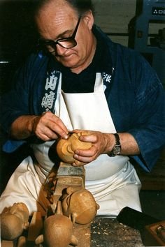 John Blundall carving puppet heads