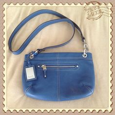 Blue crossbody / shoulder bag 100% leather crossbody bag or double strap for cute shoulder bag. Front and back outside have zipper compartments. Interior has back wall zipper and 2 slip pockets.  Only carried once - Immaculate like NEW condition. Tignanello Bags Shoulder Bags