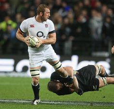 Chris Robshaw is tackled by Richie McCaw