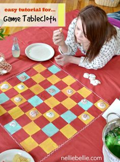 Make a game tablecloth with paint, sponge, and tablecloth! A fun gift idea! #craft #games #tablecloth #gift