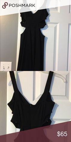 Black dress for a night out Beautiful black dress for a night out. From a local boutique. Two slits on each side. Zipper on back. Only worn once Dresses Mini