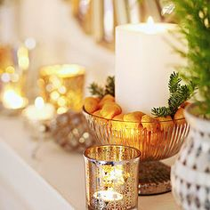 Group Different Materials - create artful decorating accents that last from autumn through year's end. Try miniature fruits -- kumquats, clementines -- tucked in a patterned glass bowl; tuck a large pillar candle at the center.
