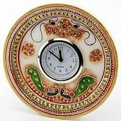 Beautiful Round Shape Marble Pillar watch with gold leaf work on it. Rajasthan(India) is the only place to manufacture marble handicraft products.  We Handicraft International is the leading manufacturers of marble handicrafts. Please visit our FB page or follow us on twitter for more and more beautiful products.