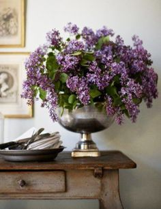 Silver urn filled with lilacs. lilacs r sooo... unrulily(coined a word) wildly beaufiful.