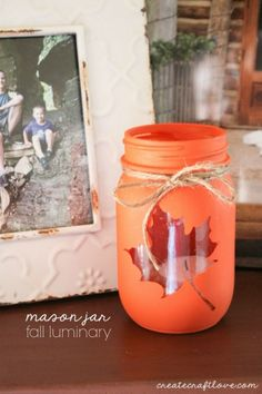 Cute and easy Mason Jar Fall Luminary - tutorial at createcraftlove.com! You could do different cutouts for all the holidays!