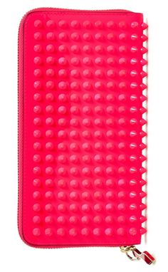 This fuchsia Louboutin wallet is the perfect mix of sweet and edgy.