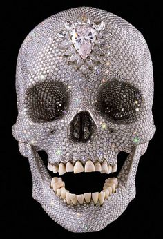 Damien Hirst's memento mori, 'For the Love of God', 2007. One platinum cast of an 18th-century human skull, 8,601 diamonds.