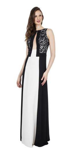 Vestido longo de crepe preto e branco com recortes geométricos e detalhes de renda. A peça faz o estilo minimalista com charme e elegância. A saia evasê equilibra a silhueta e confere leveza. Os recor...