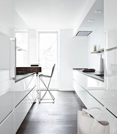 Snow white high-gloss lacquer #kitchen units, granite and walnut worktop
