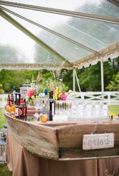 12 Delightful Drink Station Ideas: for a nautical or beach wedding, convert a canoe into a fully-stocked bar