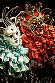 - A Pair of Venetian Masks and Costumes -