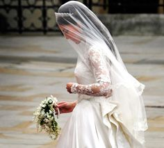 kate middleton carries a bouquet at her wedding  In the bridal bouquet was lily-of-the-valley, symbolizing a return to happiness. Also included were white hyacinths for constancy and Sweet William for gallantry (and the groom of course). For foliage, myrtle was taken from a descendent of a sprig in the Queen's own wedding in 1947, when she was still Princess Elizabeth.