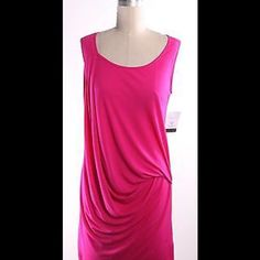 NWT Michael Kors size XL scoop neck gathered dress New with tags cotton feel (viscose and elastane) pink Michael Kors dress. Sleeveless with ruching on left side. Asymmetrical hem, no stains, pulls or defects! Feel free to offer or bundle, and ask any questions! No deals outside of poshmark, thanks! Authentic Michael Kors Dresses