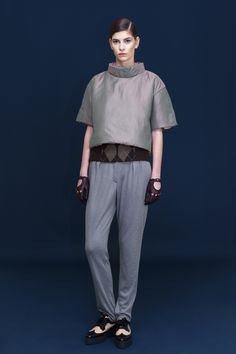 Silver blouse over a waist corsage and soft jersey trousers.