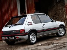 Peugeot 205 GTI (1985) My second car.  Similar to this. It started out as silver then I painted it blue.