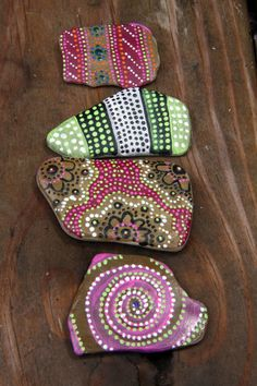 Four hand painted pebbles in dotty designs by GxRxAxCxE on Etsy, $14.99