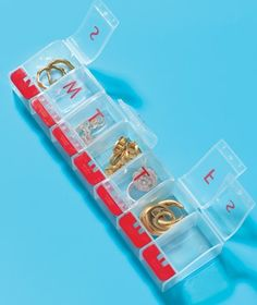 Use a pill organizer to keep your small jewelry items safe and tangle free while you travel.