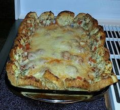 Meatball Sandwich Casserole..1 bag frozen meatballs, one jar marinara...heat on stove until hot and bubbly about 10 min..can doctor it up if you like. Pour into 13x9 pan. Cut a loaf of Italian brad...butter and garlic and place around edges of pan pushing meatballs toward center. Top with mozzarella and Parmesan. Bake 20 min or until cheese is melted at 400