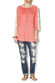 Coral top with lace extending from shoulder to wrist