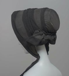 Mourning Bonnet: ca. 1840-1845, American, slightly ribbed silk trimmed with folds of black crèpe.