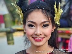 https://flic.kr/p/CC743i | 2015-11j Lanna Thai Street Parade (07) | Closeup street portrait (outdoor headshot) of an adorable, dressed-up Thai girl with beautiful eyes, taking part in the village's historical Lanna Thai street parade and producing the famous Thai smile; Mae Chaem, Chiang Mai Province, Northeast Thailand. More context: matthahnewaldphoto.blogspot.ca/2015/12/facing-lanna-thai-..., matthahnewaldphoto.blogspot.ca/2015/12/catching-thai-smil....