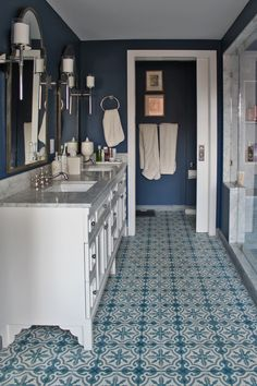 Blue wall with white doorframe - bathroom thoughts