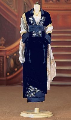 Blue Velvet Gown (Rose) Ensemble from Titanic. It is made by Franklin Mint.  http://franklin-mint.minimodelfilmstuff.co.uk/franklin-mint-collectable/titanic-rose-blue-velvet-gown-ensemble-franklin-mint-b11yu67 Please note: dress form not included....