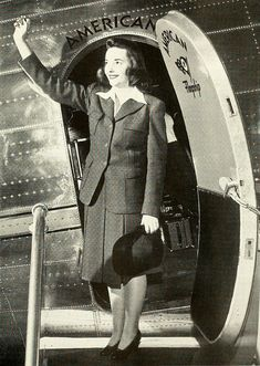 An airline hostess waving from the steps of a Marshall Field American plane, 1942. Vintage flight_attendant 1940s #travel #airplanes