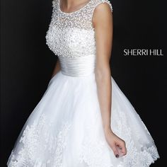 White Prom/ Homecoming Dress This is a beautiful white dress only worn once . The top is a heavy layer of beautiful pearls and the bottom is laced to perfection ☺️ Sherri Hill inspired dress size 16/18 Sherri Hill Dresses Prom