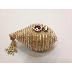 Real nariyal decorated with pearl and zardosi threads