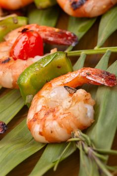 This exciting recipe really packs a flavor punch. Imagine the juiciness of hot grilled shrimp paired with a mango and rum marinade. The grilled shrimp kabobs also have grilled bell pepper and cherry tomatoes for added color and flavor. This shrimp appetizers recipe uses rosemary sprigs instead of wooden kabobs, which infuses the kabobs with flavor and looks good too.