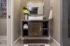 Small bath with shower (no shower curtain needed). Floating vanity takes up less floor space and visually, seems less bulky in such a small space.