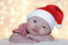 baby's first christmas pictures 2 months old.