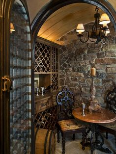 This is about the size of wine cellar I'll be putting in our house when we build. Shelving and racks (on top) on both sides. Dark wood, stonework, and concrete. Obviously temperature controlled and all that jazz.